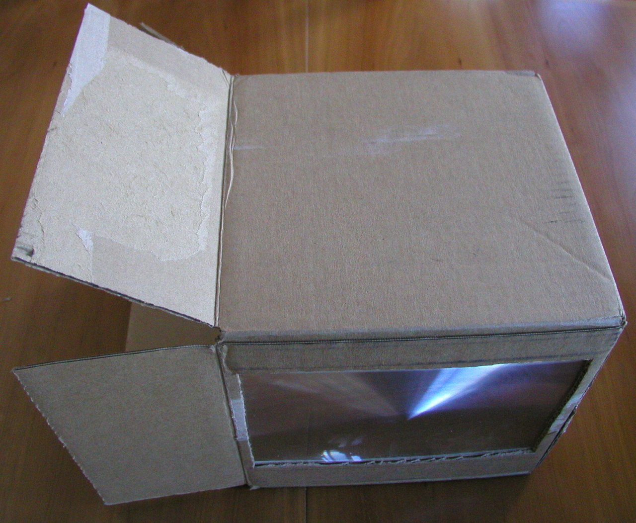 Box with lens